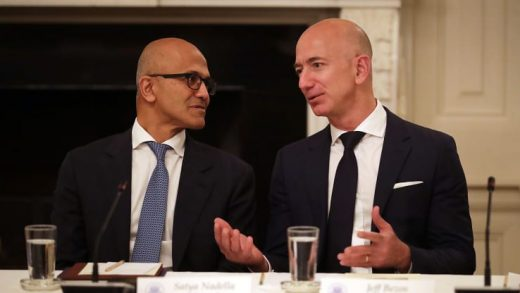 Microsoft CEO Satya Nadella (L) and Amazon CEO Jeff Bezos visit before a meeting of the White House American Technology Council in the State Dining Room of the White House June 19, 2017 in Washington, DC.
