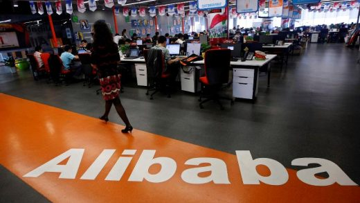 An employee walks past a logo of the Alibaba Group at its headquarters on the outskirts of Hangzhou, Zhejiang province, in this May 17, 2010 file photo. Alibaba Group's plans to revolutionise China's retail industry, investing $16 billion in logistics and support by 2020, will open up China's vast interior and bring access to hundreds of millions of potential new customers. Picture taken May 17, 2010. REUTERS/Stringer (CHINA - Tags: BUSINESS SCIENCE TECHNOLOGY LOGO) CHINA OUT. NO COMMERCIAL OR EDITORIAL SALES IN CHINA