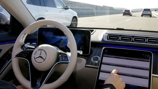 FILE PHOTO: An employee of Daimler demonstrates steering by the Drive Pilot Level 3 autonomous driving system in a new Mercedes-Benz S-Class limousine at the company's test center near Immendingen, Germany October 14, 2020. REUTERS/Arnd Wiegmann