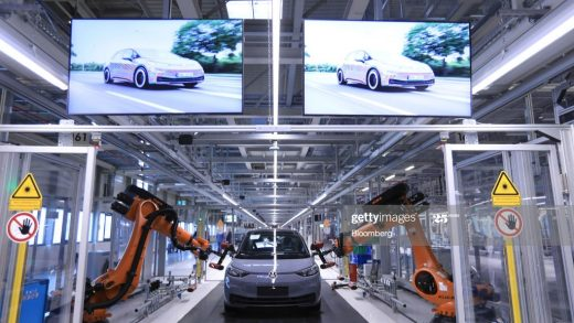 Robotic arms manufactured by Kuka AG scan the body of a fully assembled a Volkswagen AG (VW) ID.3 electric automobile during quality checks at the automaker's factory in Zwickau, Germany, on Monday, Nov. 4, 2019. Angela Merkels visit to a revamped VW electric-car plant in Zwickau on Monday is a stark reminder of what's at stake both for the German chancellor and VW boss Herbert Diess. Photographer: Krisztian Bocsi/Bloomberg via Getty Images