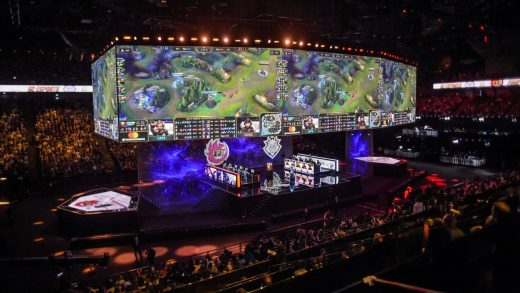 E-sport fans watch the match of the 2020 League of Legends World Championship televised on a screen at a Tencent V-station in Shanghai, China Saturday, Oct. 31, 2020.
