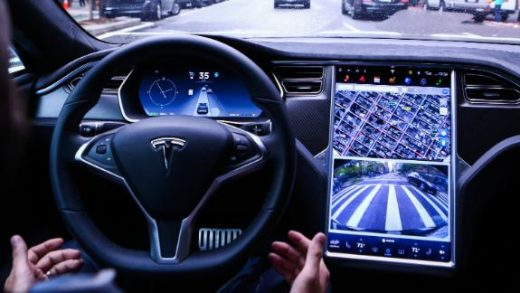 A driver rides hands-free in a Tesla Motors Inc. Model S vehicle equipped with Autopilot hardware and software in New York, U.S. on Monday, Sept. 19, 2016. The latest overhaul of the car's operating system, known as Tesla 8.0, biggest change is how Autopilot shifts towards a heavier reliance on its radar than its camera to guide the car through traffic. Photographer: Christopher Goodney/Bloomberg