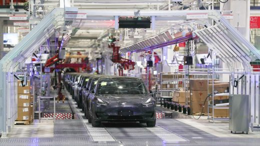 Tesla China-made Model 3 vehicles are seen during a delivery event at its factory in Shanghai