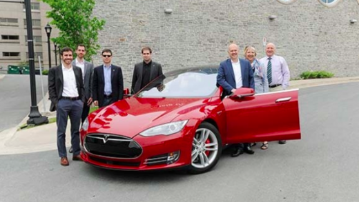 Battery expert Jeff Dahn inside the frunk of a red Model S [Source: dal.ca]