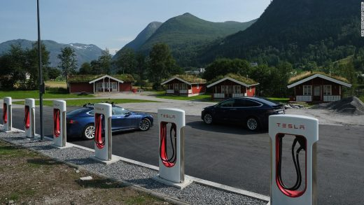 SKEI, NORWAY - AUGUST 12: Tesla cars stand at a Tesla Supercharger charging station on August 12, 2020 in Skei, Norway. Norway has the highest percentage of electric cars per capita in the world. In March, 2020, all-electric electric car sales accounted for 55.9% of new car sales. (Photo by Sean Gallup/Getty Images,)